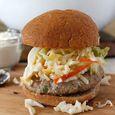 Jerk Turkey Burger with Creamy Feta and Mango-Apple Slaw