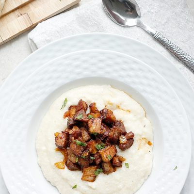 Smoky Barbecue Ribs over Cheesy Grits