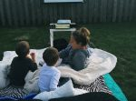 We leave for Maine at the beginning of August, so we only have about a month left of our Summer in Washington! We're filling our weekends with fun and trying to cross some things off our summer bucket list! Ive always wanted to have an outdoor movie night with the kids! So last weekend, we made it happen! We picked a movie they hadn't see yet, we watched The Lion King, the original, the boys LOVED it! They were up dancing around and laughed their butts off at timone and pumba! They watch The Lion Guard occasionally on Disney, so it was kinda fun explaining the difference to them! So steps to the perfect outdoor movie night? have a fire and make s'mores before it gets to dark! We live in the PNW, where it stays light out until about 930-10:00 so we had to keep the kids busy for a couple hours after we put the little babe to bed! We sat around the fire and made s'mores and it was so nice to just have some time with the two older boys! have lots and lots of candy! & popcorn! We took the kids to the store that morning and let them pick out two types of candy each and then that night during the movie, let them just go to town! I kept pushing for more chocolate at the store, but they just werent having it...thennn, the chocolate was the first to go, what do you know? :P set up lots of blankets and pillows and cushions and crawl and get snuggly with your kiddos because its the best thing ever when they snuggle into the crook of your arm or lay their head across your chest