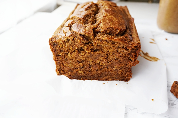 Perfectly spiced, warm and cozy Whole Wheat Pumpkin Banana Bread, perfect for an afternoon snack smeared with nut butter or warmed in the morning with your coffee, you'll just love this healthy treat!